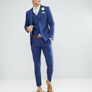 Skinny suit in blue. In excellent condition.